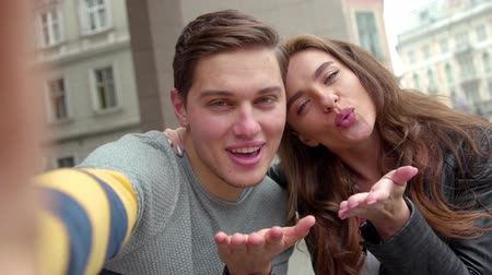 air kiss : Happy Couple Making Selfie Photo And Having Fun At Street Stock Footage