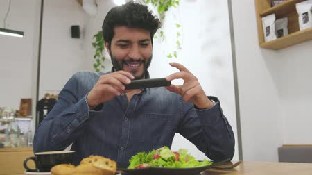 Man Making Food Photo On Mobile Phone At Restaurant Wideo