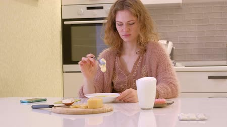 phablet : woman having breakfast in the kitchen