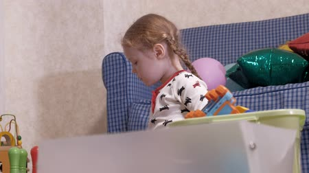 nanny holding : Young mother with little daughter sitting on floor and playing with toys. Stock Footage