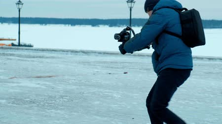 microstock : Camera operator Walk with electronic stabilizer in winter