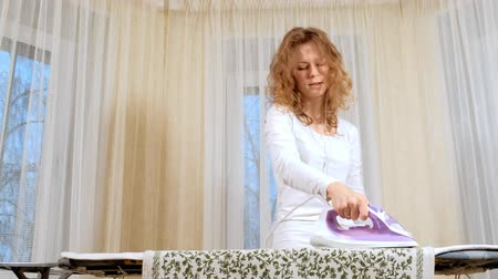 sprzataczka : Attractive and beautiful woman ironing clothes at home Wideo