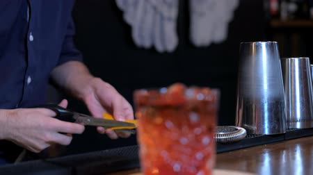 shaker : Expert barman is making cocktail at bar