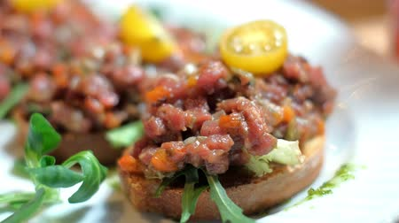 bruschetta : bruschetta, on slices of toasted baguette garnished with basil