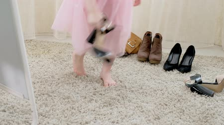piada : Little girl trying on mummys shoes