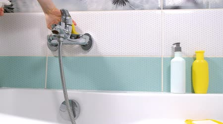 sanitize : A woman cleaning bath at home. Female washing bathtub and faucet Stock Footage