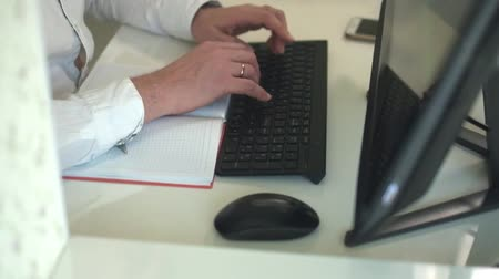 computer keyboard : Close-up of hands typing on a keyboard in an home office
