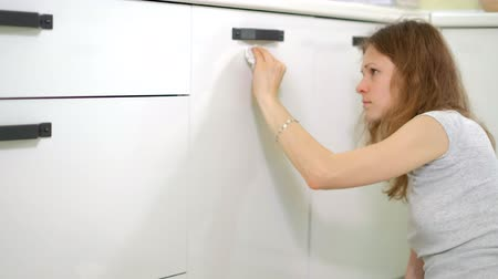 disinfectant : young woman cleaning with duster at kitchen at home