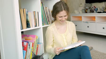 biblioteca : young woman searching for a book. student selecting bookshelf library. female taking book from shelf in library. Stock Footage