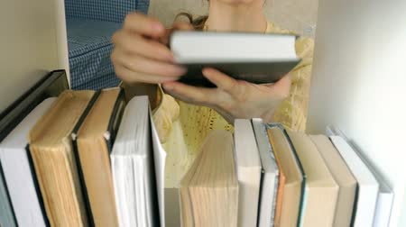 literatura : young woman searching for a book. student selecting bookshelf library. female taking book from shelf in library. Stock Footage