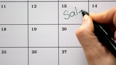 kleszcz : Sign the day in the calendar with a pen, draw a sale