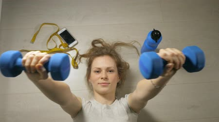 weightlifting : Fitness mature woman working out with dumbbells. Healthy lifestyle