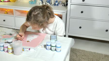 education kids : Woman paint with colored brush. Games with children affect the development of early children. Stock Footage