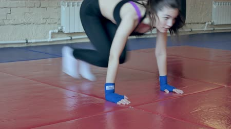 bandagem : An energetic woman in boxing in the gym, coaches in elastic bandages
