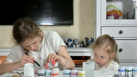 affect : Mother and child paint with colored fingers. Games with children affect the development of early children. Stock Footage