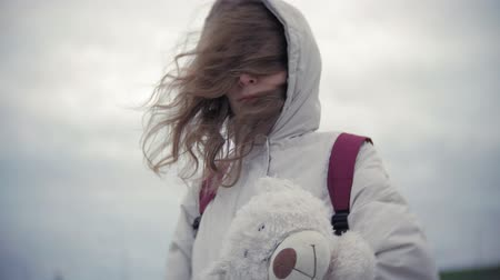 полярный : beautiful woman in warm clothes walking outdoors with a polar bear Стоковые видеозаписи