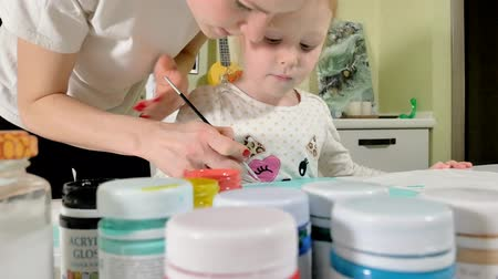 affect : Mother and child paint with colored brush. Games with children affect the development of early children.