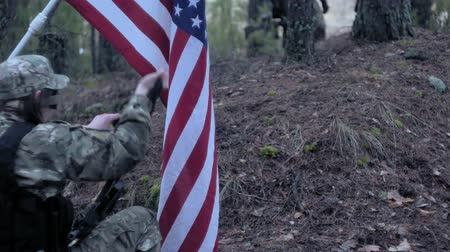 força : Soldiers in camouflage with combat weapons and in the US in the forest, military concept