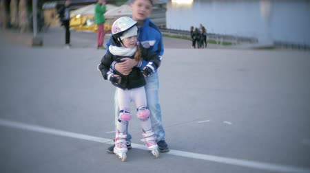 inline : little girl dresses learn to skate. Concept: sport, lifestyle, health. Stock Footage