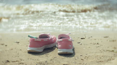 footwear : Summer shoes on the beach. in the background of a girl walking and dancing on the sand