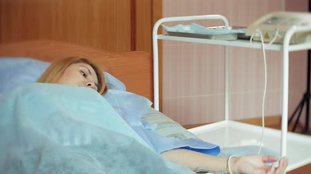 uv : A woman in a hospital undergoing UV blood irradiation therapy