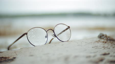 deep eyes : Points in a round frame lie on the shore in the background of the waves
