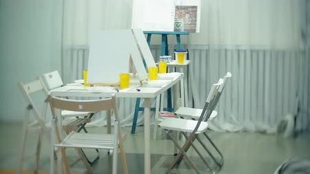 afro amerikan : art school, creativity and concept with easels, brushes and palettes, still life at the studio