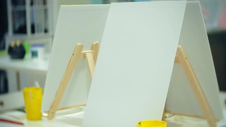 африканского происхождения : art school, creativity and concept with easels, brushes and palettes, still life at the studio
