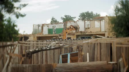 demolishing : Excavator destroys the old building Stock Footage