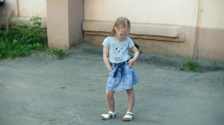 благодать : A little girl, a charming young talented dancer dancing in the open air