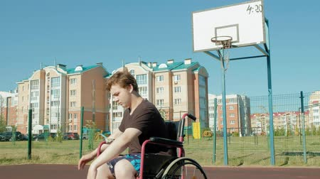 aro : Disabled man plays basketball from his wheelchair, On open air
