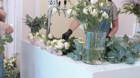 decorating : Florist prepares a bouquet of flowers for sale Stock Footage