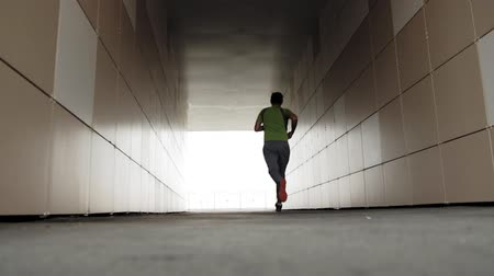 motiváció : Young athlete runner in the city super slow motion