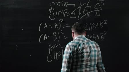 essay : A brilliant mature mathematician brings a big board and completes an essay Complicated mathematical formula equation