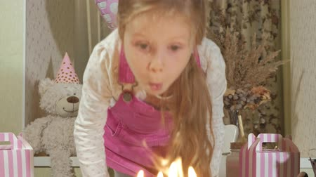 üfleme : Happy girl with birthday cake with candles Stok Video