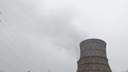 fosilní : Multiple Coal Fossil Fuel Power Plant Smokestacks Emit Carbon Dioxide Pollution