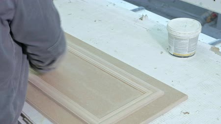 újra : a woman, a worker, spat the door surface. production of interior doors of wood