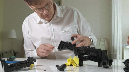 ремонт : A man repairs a coffee machine coffee machine, coffee maker repair shop