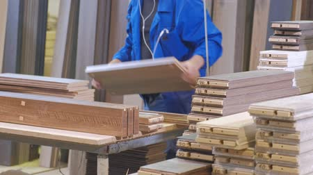 timber cutting : the process of collecting doors from wooden blanks, the production of rustic interior doors Stock Footage