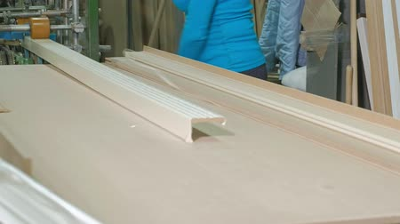 piŁa : the process of veneering wood blanks, the production of wooden doors