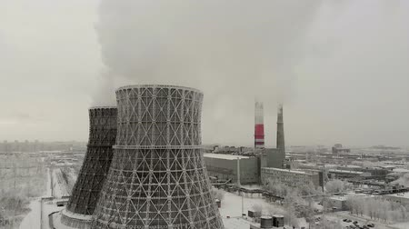 atirar : Steam, smoke from pipes at a thermal power station. Aerial. Stock Footage