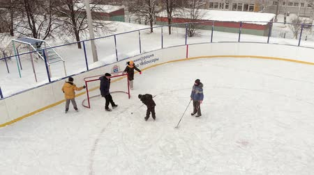 ice hockey rink : Cheboksary, Russia - January 5, 2019: children skate and play hockey at the rink, the concept of sports recreation, aerial, copter shoot Stock Footage