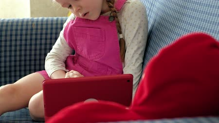 plaything : Little girl coloring on a tablet