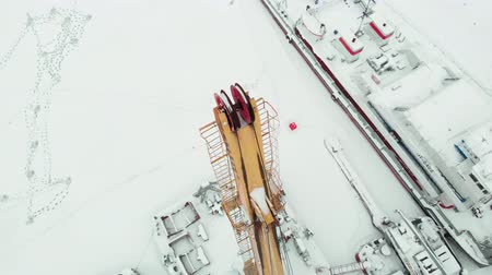 alguns : frozen seaport, winter berths of ships, copter shoot