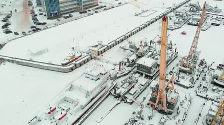 mooring : frozen seaport, winter berths of ships, copter shoot