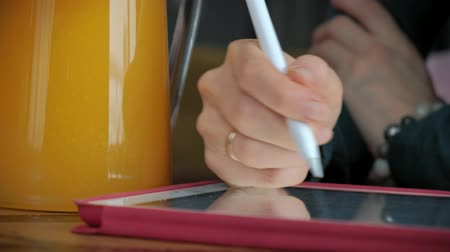using stylus : Attractive young woman with tablet in cafe, freelancer concept