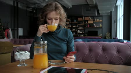 diner : Attractive young woman with tablet in cafe, freelancer concept