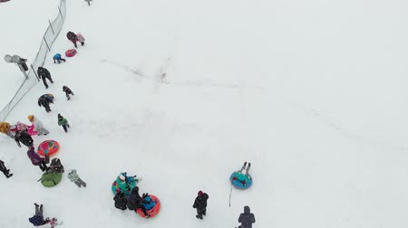 trenó : Happy people having fun on the snow in winter park. aerial survey, copter shoot