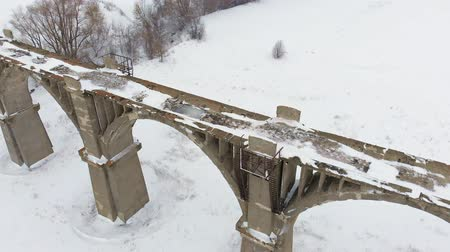 lő : old railway aqueduct, stone bridge. snow, winter time. aerial, copter shoot