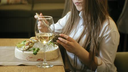 antipasti : Beautiful blonde woman eating and drinking in restaurant, lunch break Stock Footage
